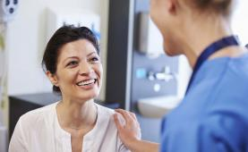 Primary care provider talks to patient