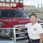 Emergency Department Worker in front of Ambulance